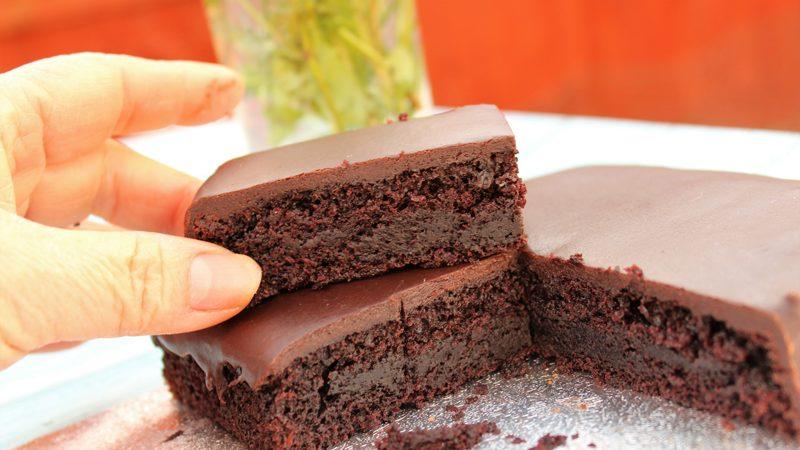 Slice chocolate cake served for tea