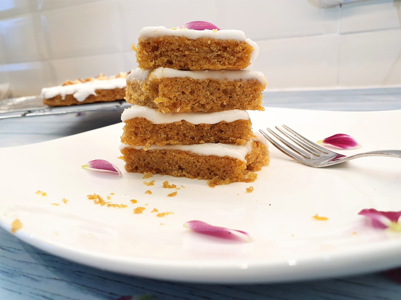 A stack of carrot cake slices.